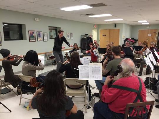 Kim Diehnelt leads the Me/2 Orchestra in a rehearsal at the Miller Community and Recreation Center in Burlington on Nov. 14, 2019.