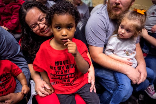 Isaiah Moreno, left, 3, and Lauralye Boggs, right, 2, wait for their adoptions to be finalized at the County Court at Law No. 5 on Friday, November 15, 2019 in Corpus Christi.