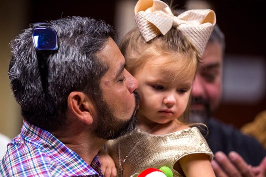 Armando Rios gives his daughter, Ashlyn Rios, 3, a kiss following the completion of her adoption at County Court at Law #5 on Friday, November 15, 2019.