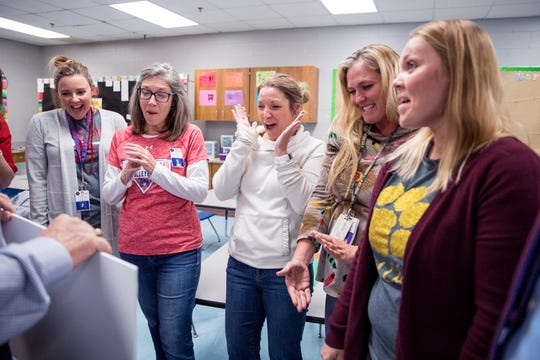 T.M. Clark Elementary School kindergarten teachers Stacy McNeal, from left, Michelle Northam, Peggy Hamrick, Amy Radford and Hillary Caceres learn that they are recipients of a $2,500 grant from the Gregory-Portland Education Foundation on Friday, November 15, 2019.