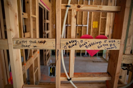 Hand written notes where written on the studs thought out the home being constructed for wondered veteran Julio Martinez and his family on Friday, Nov. 15, 2019.