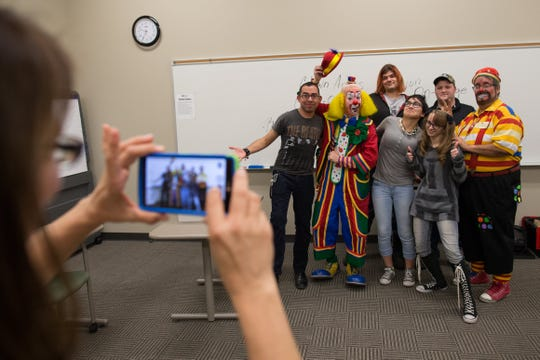"Denies Underwood of Odem takes a photo of Orlando Valdez,Danny ""Lanky"" Kollaja, Benjamin Woodard, Christina Moreno, Katie Underwood, Ben Abbott, and Mark Johnson as Bingo at the end of their first Clown Class at Del Mar College, Tuesday, Feb. 9, 2016."