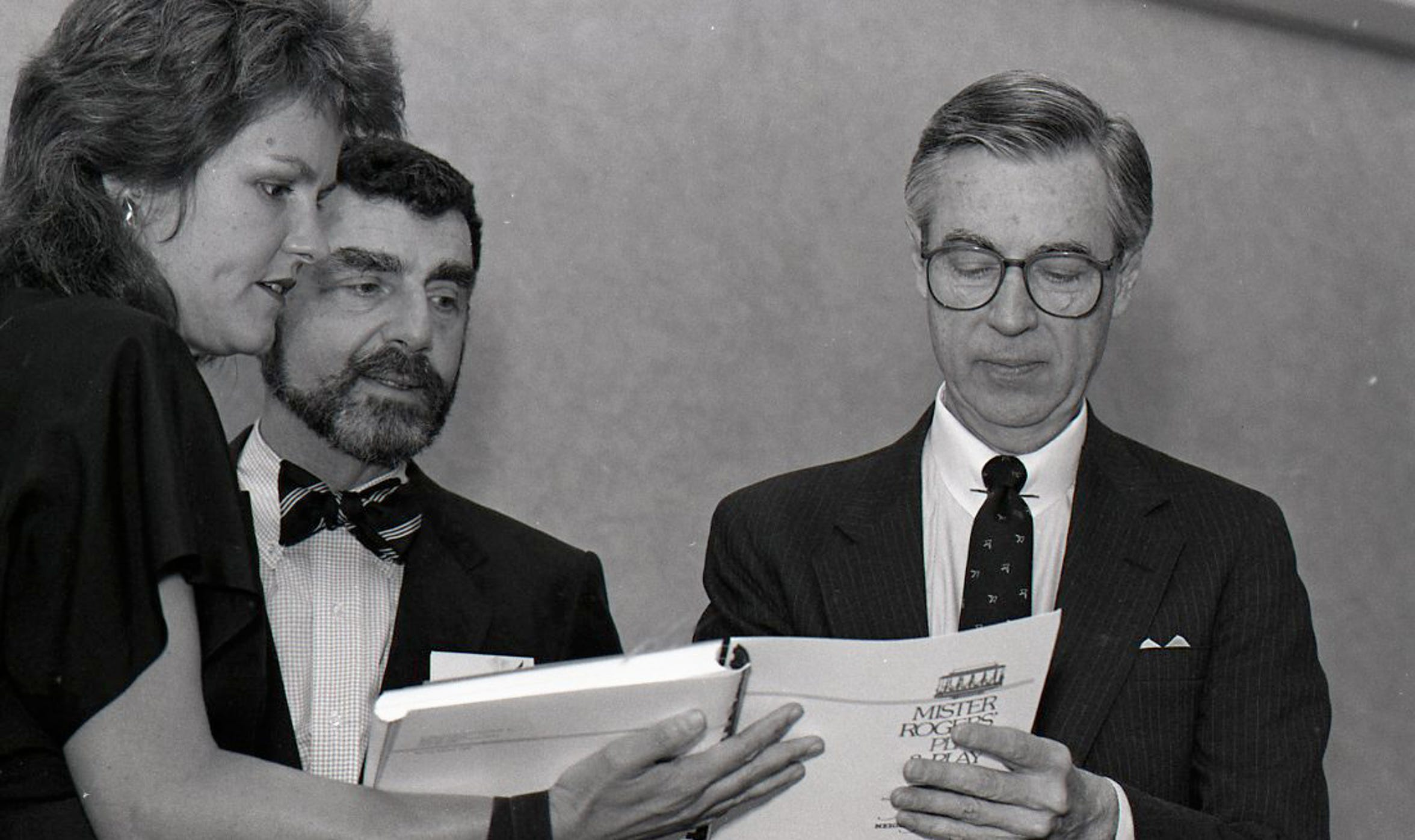 "Fred Rogers of ""Mister Rogers' Neighborhood"" autographs a book during his appearance at the Conference of Southwest Foundations annual meeting on May 13, 1988 held at the Hershey Hotel in Corpus Christi."
