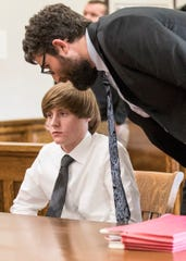 Defense attorney Ryan Shepler talks with Jaden Churchheues after Churchheues pleaded not guilty to murder, involuntary manslaughter, and reckless homicide in connection with the death of Chillicothe native Victoria Schafer to Common Pleas Judge John Wallace on Nov. 15, 2019, in Logan, Ohio.