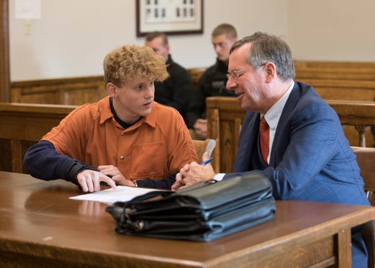 Jordan Buckley points to a court document and asks questions to attorney Bob Toy before  pleading not guilty to murder, involuntary manslaughter, and reckless homicide in connection with the death of Chillicothe native Victoria Schafer to Common Pleas Judge John Wallace on Nov. 15, 2019, in Logan, Ohio.