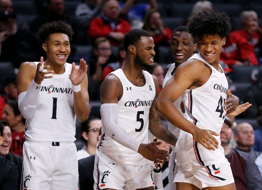 The Cincinnati Bearcats celebrates as forward Rob Banks (45) enters the game late in the second half of the NCAA basketball game between the Cincinnati Bearcats and the Alabama A&M Bulldogs at Fifth Third Arena in Cincinnati on Thursday, Nov. 14, 2019. The Bearcats won 85-53.