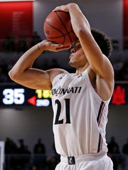 Cincinnati Bearcats guard Jaevin Cumberland (21) shoots from three point range in the second half of the NCAA basketball game between the Cincinnati Bearcats and the Alabama A&M Bulldogs at Fifth Third Arena in Cincinnati on Thursday, Nov. 14, 2019. The Bearcats won 85-53.