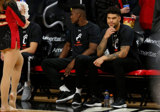 Cincinnati Bearcats guard Jarron Cumberland (34) wears plain clothes as he sits on the bench in the first half of the NCAA basketball game between the Cincinnati Bearcats and the Alabama A&M Bulldogs at Fifth Third Arena in Cincinnati on Thursday, Nov. 14, 2019.