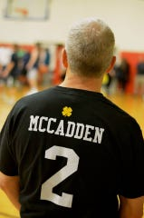 Andy McCadden wears a shirt displaying his son Connor's jersey number