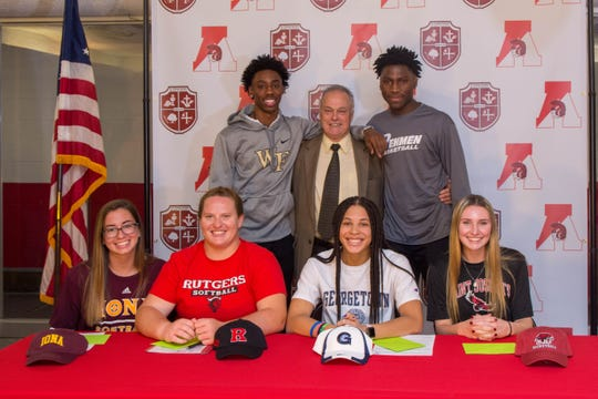 St. Thomas Aquinas' (from left to right back row): Quadry Adams, athletic director Jerry Smith, Derrick Grant; (front row left to right): Alyssa DeJianne, Megan Herka, Kelsey Ransom and Emma Boslet.