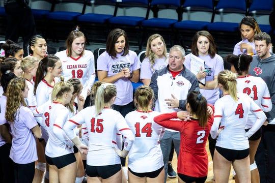 Cedar Falls head coach Matt Johnson talks with players during the Class 5A girls' volleyball state championship game, Friday, Nov., 15, 2019, at the U.S. Cellular Center in Cedar Rapids, Iowa.