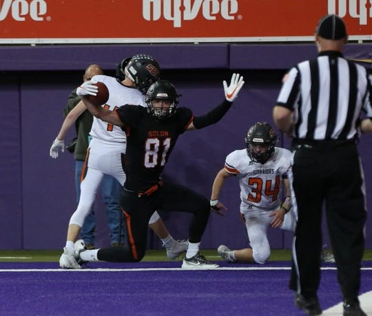 Solon's AJ Coons celebrates a touchdown during the Spartans' 43-36 win over Sergeant Bluff-Luton in the Class 3A semifinals at the UNI-Dome.