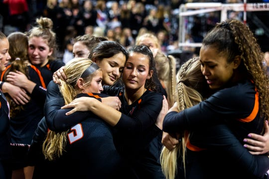 West Des Moines Valley players console each other during the Class 5A girls' volleyball state championship game, Friday, Nov., 15, 2019, at the U.S. Cellular Center in Cedar Rapids, Iowa.