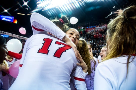 Cedar Falls Tigers celebrate as balloons fall from the rafters after defeating West Des Moines Valley during the Class 5A girls' volleyball state championship game, Friday, Nov., 15, 2019, at the U.S. Cellular Center in Cedar Rapids, Iowa.