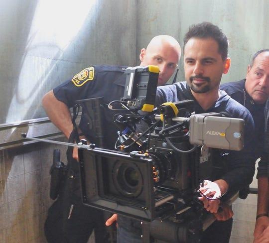 "Director Sam Logan Khaleghi at work on the set of ""Devil's Night: Dawn of the Nain Rogue."""