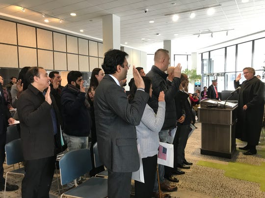 Seventeen people representing 11 countries take the Oath of Allegiance to become U.S. citizens during a naturalization ceremony Nov. 15, 2019 in Mount Clemens.