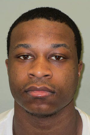 Antonio Beck, 23, of Detroit, was charged Friday in the carjacking of an 80-year-old Grosse Pointe Farms couple who were assaulted at a gas station.