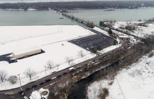 Traffic backs up on the Grosse Ile Bridge toll booth Friday, Nov. 15, 2019.