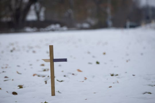 A cross memorializing Zachary Winston is placed on East Erie Street near Albion College in Albion, Thursday, Nov. 14, 2019.