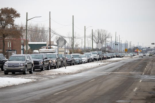 Cars lined up on West Jefferson Avenue in Riverview to get across Grosse Ile Toll Bridge, Friday, Nov. 15, 2019.