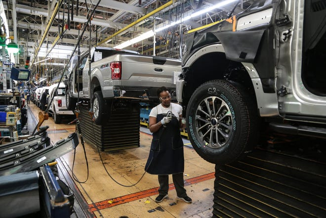 Workers work on the assembly line for the Ford F-150 trucks at the Ford Rouge Plant in Dearborn on Thursday, September 27, 2018.
