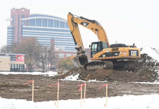 Heavy machinery is at work on a plot of land at the corner of the Lodge Freeway and Selden, part of a $100 million Midtown West development project, with the Motor City Casino in background.