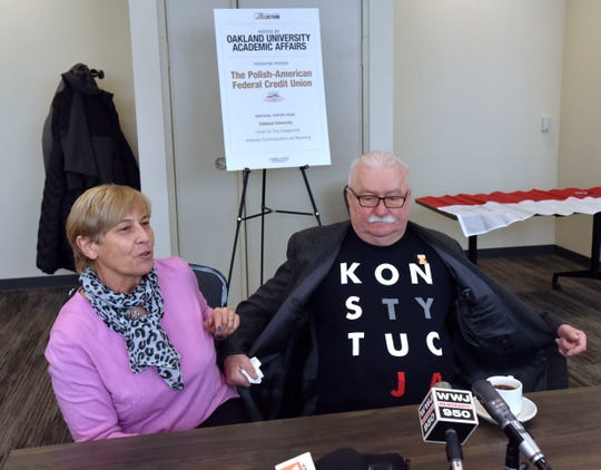 Former Poland President Lech Walesa shows off his T-shirt that translates into 'Constitution.'