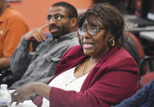 DeBorah Harris answers a question during a recent Friday session in an employment training program led by the nonprofit Generation and Goodwill Industries of Greater Detroit.