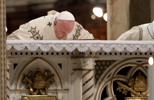 Pope Francis kisses the altar as he celebrates Mass at the St. John's at the Lateran Cathedral on the occasion of the festivity of the basilica dedication, in Rome, Saturday, Nov. 9, 2019.