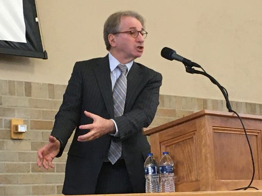 Renowned attorney Barry Scheck, co-founder of the Innocence Project, addresses an audience at a University of Michigan discussion about wrongful convictions