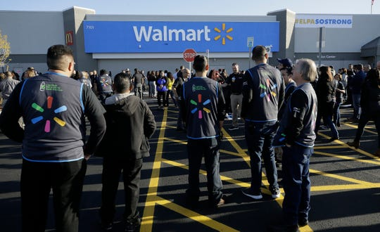 Walmart employees gather outside the Walmart store for a reopening event, Thursday, Nov. 14, 2019 in El Paso, Texas.  Customers returned to the store that been closed since August when a gunman opened fire at the store and killed 22 people.
