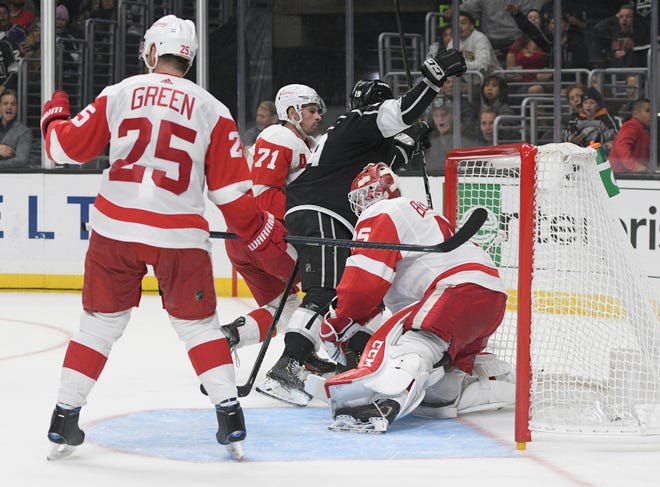 Los Angeles Kings left wing Alex Iafallo, center, reacts after scoring past Detroit Red Wings goalie goalie Jonathan Bernier during overtime.