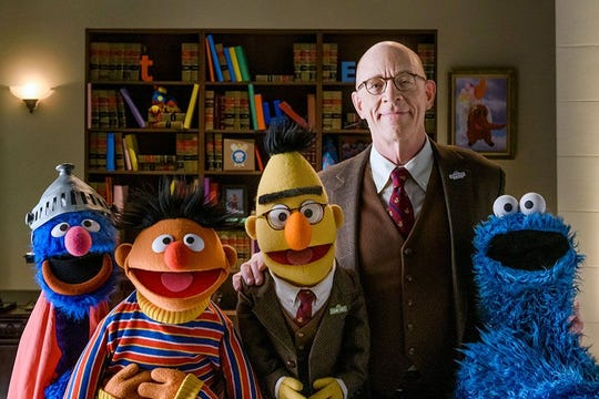 """J.K. Simmons and characters from """"Sesame Street"""" appear in a Farmers insurance commercial"""