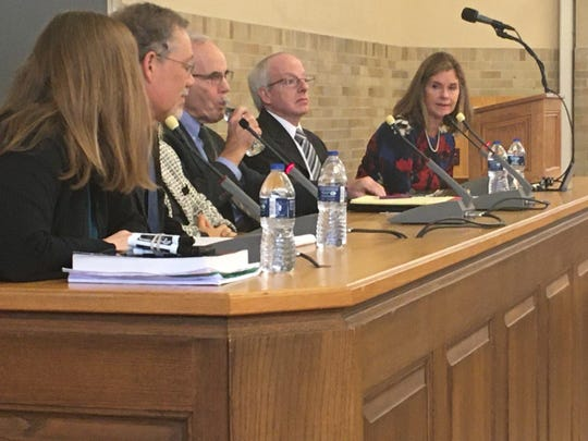 Michigan Supreme Court Chief Justice Bridget McCormack (right), leads a panel of legal experts discussing wrongful convictions.
