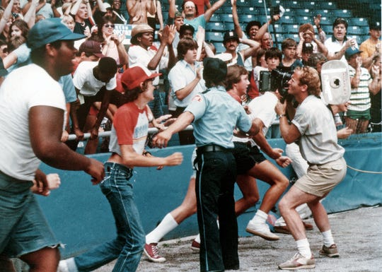 "Fans rush the field at Tiger Stadium while shooting ""Tiger Town."""