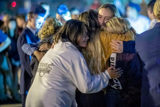 People hug each other during a vigil for the Saugus High School shooting victims at Central Park, Thursday, Nov. 14, 2019, in Santa Clarita, Calif.