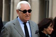 Roger Stone accompanied by his wife Nydia Stone, right, arrives at federal court in Washington, Thursday, Nov. 14, 2019.