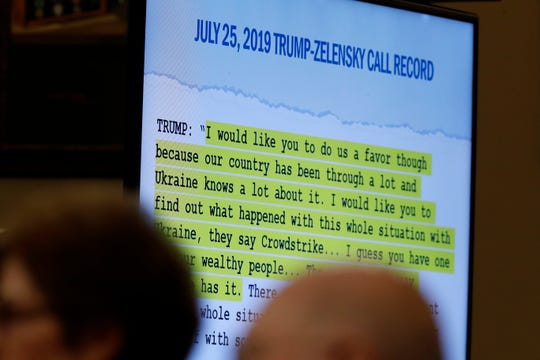 A quote is shown on a scene while former Ambassador to Ukraine Marie Yovanovitch testifies before the House Intelligence Committee on Capitol Hill.
