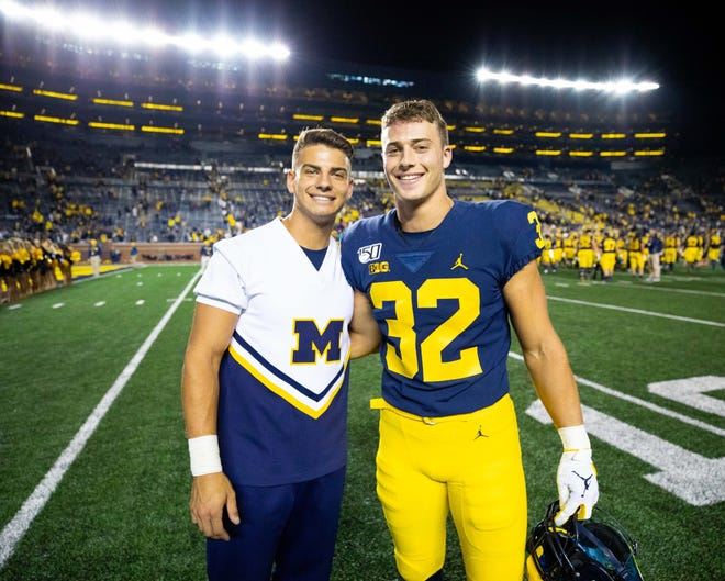 Nathan Grodman, left, and brother Louis Grodman are pictured after a game at the Big House.