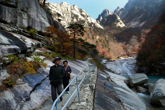 FILE - In this Oct. 23, 2018, file photo, local tourists walk on the trail at Mount Kumgang, known as Diamond Mountain, in North Korea.