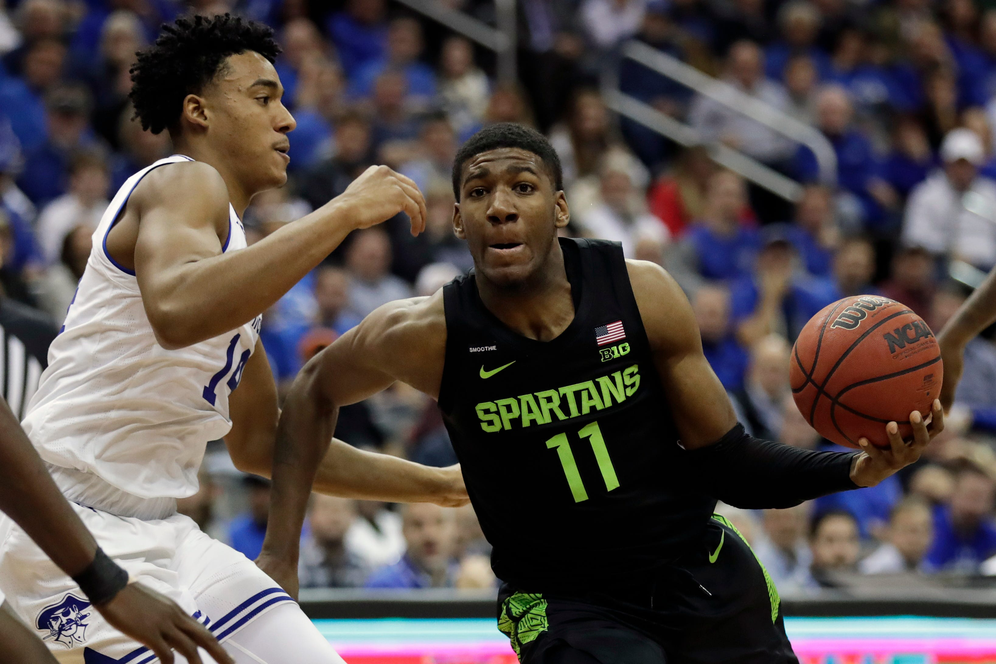 Michigan State`s Henry says he`s OK after injury...