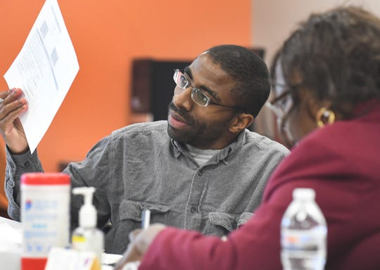 Tyree Rumph works on resume building during the contact call agent class at Goodwill North End Career Center in Detroit on Nov. 15.