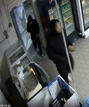 Both suspects were dressed all in black with white shoes, police said.