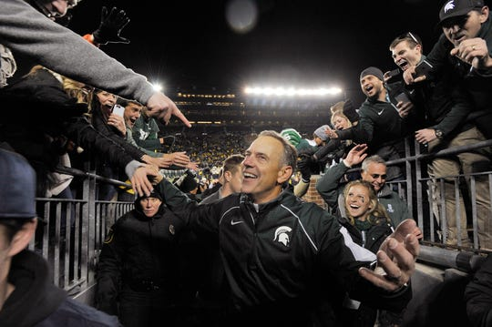 Michigan State coach Mark Dantonio is all smiles as he walks off the field after the Spartans' win at Michigan Stadium in 2015.