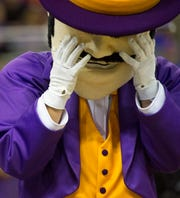 Evansville's mascot Ace Purple reacts after a foul is called on the University of Evansville Purple Aces during the first half of the  University of Evansville Purple Aces vs Indiana University Kokomo Cougars game at Ford Center Thursday evening, Nov. 14, 2019.