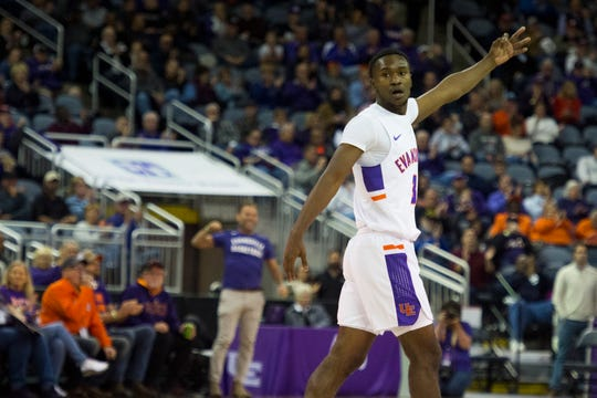 Evansville's Jawaun Newton (3) holds out three fingers after the Purple Aces sink a three-point shot during the first half of the  University of Evansville Purple Aces vs Indiana University Kokomo Cougars game at Ford Center Thursday evening, Nov. 14, 2019.