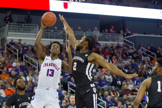 Evansville's DeAndre Williams (13) takes a shot during the first half of the  University of Evansville Purple Aces vs Indiana University Kokomo Cougars game at Ford Center Thursday evening, Nov. 14, 2019.