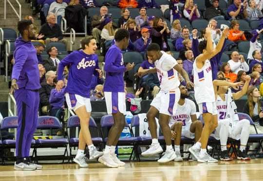 University of Evansville Purple Aces celebrate from the bench during the second half of the  University of Evansville Purple Aces vs Indiana University Kokomo Cougars game at Ford Center Thursday evening, Nov. 14, 2019.