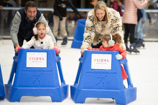 Adam and Taryn Scher skate with Avery, 4, and Charleston, 3, after the 2019 season opening ceremony for the United Community Bank Ice on Main Friday, Nov. 15, 2019.