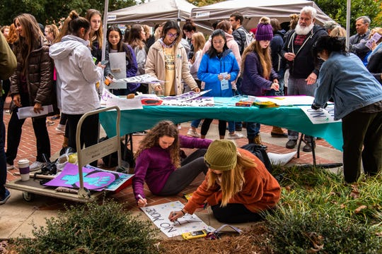 Students create signs before the Women's March Against Violence at Clemson University Friday, November 15, 2019. The march will follow a route of 0.9 miles from Tillman Hall to Sikes Hall in support of the 90% of college student survivors who do not feel safe reporting sexual assault.